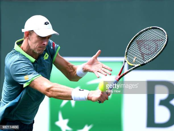 Kevin Anderson of South Africa hits a backhand in his match against Pablo Carreno Busta of Spain during the BNP Paribas Open at the Indian Wells...