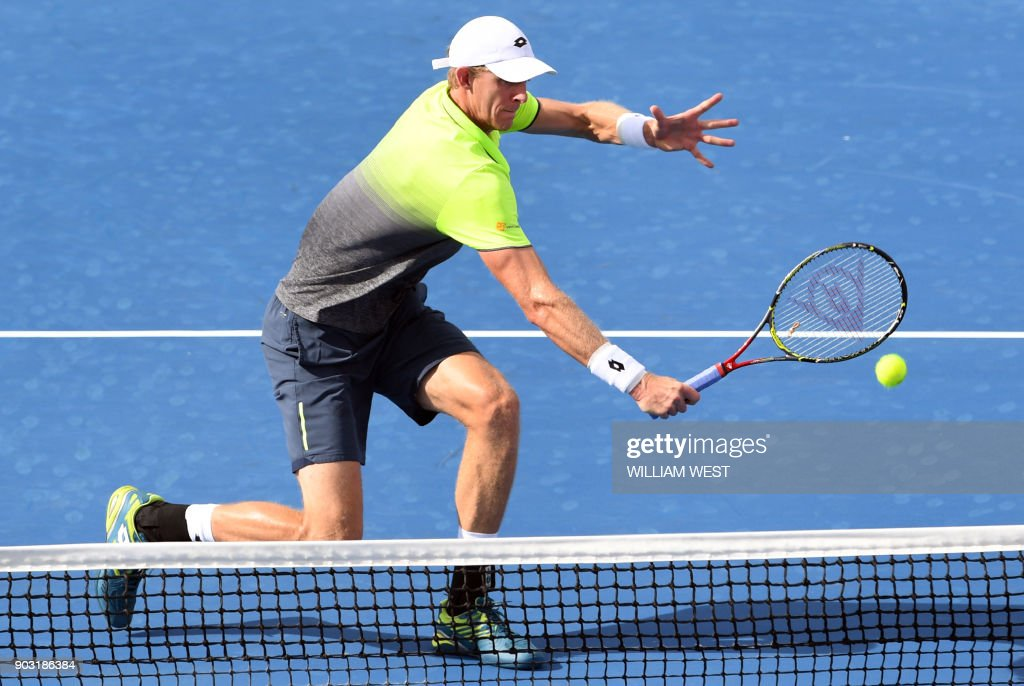 Kevin Anderson of South Africa hits a backhand return during his match against Marcos Baghdatis of Cyprus at Kooyong Classic tennis tournament in Melbourne on January 10, 2018. /