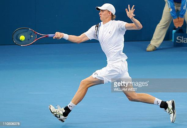 Kevin Anderson of South Africa hits a forehand return during his loss to Andy Roddick of the US in their semifinal match at the Brisbane...