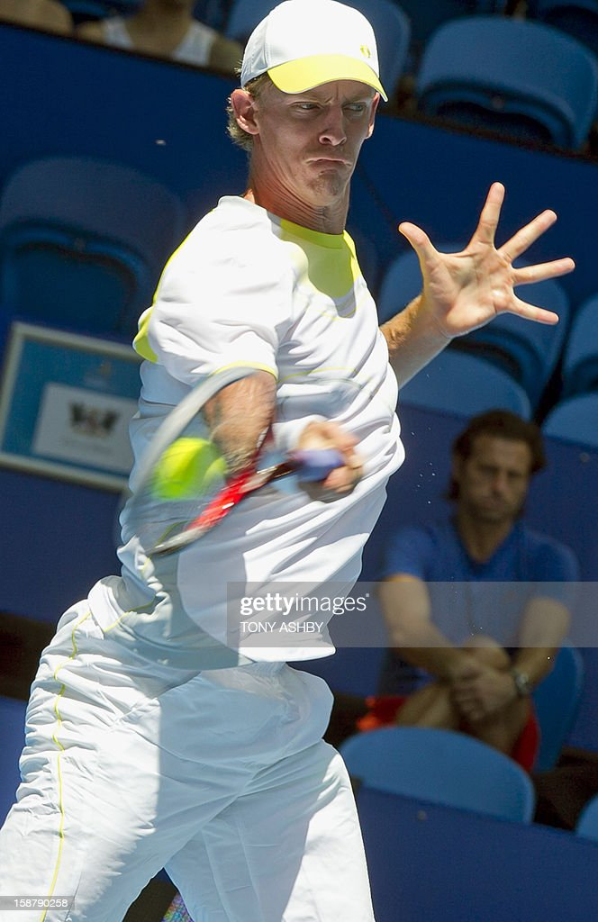 Kevin Anderson of South Africa hits a return against Fernando Verdasco of Spain during their first session men's singles match on day one of the Hopman Cup tennis tournament in Perth on December 29, 2012. AFP PHOTO/Tony ASHBY USE