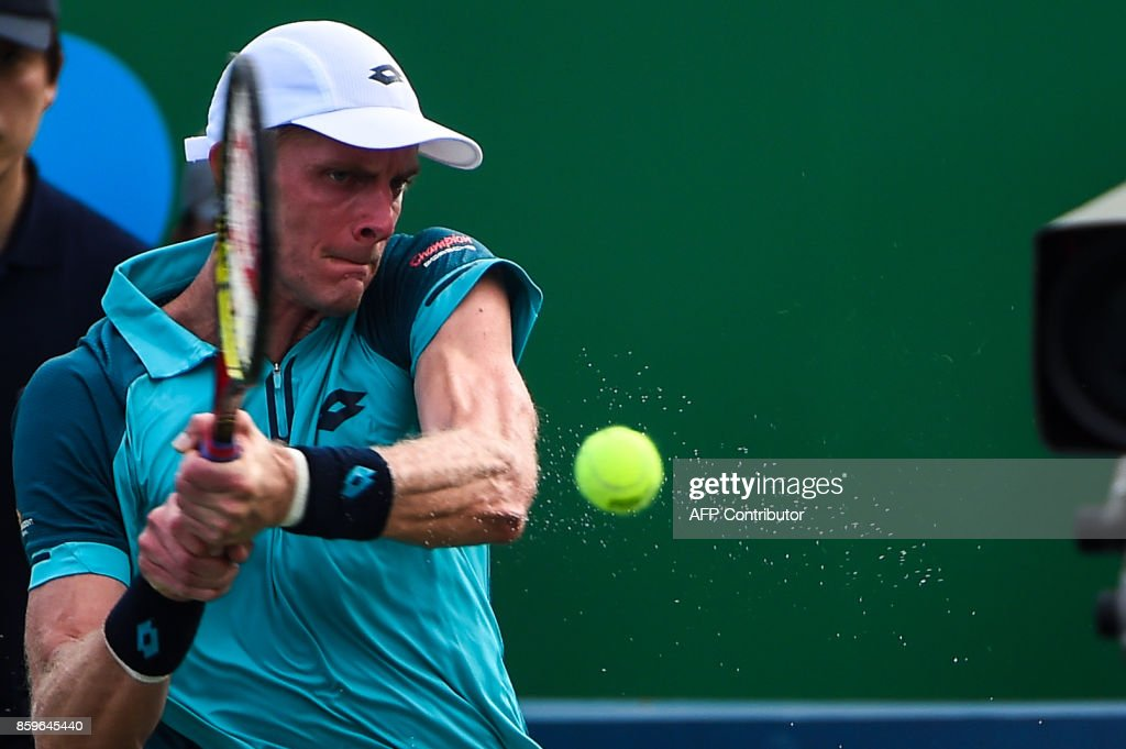 Kevin Anderson of South Africa hits a return during the men's singles against Adrian Mannarino of France at the Shanghai Masters tennis tournament in Shanghai on October 10, 2017. /