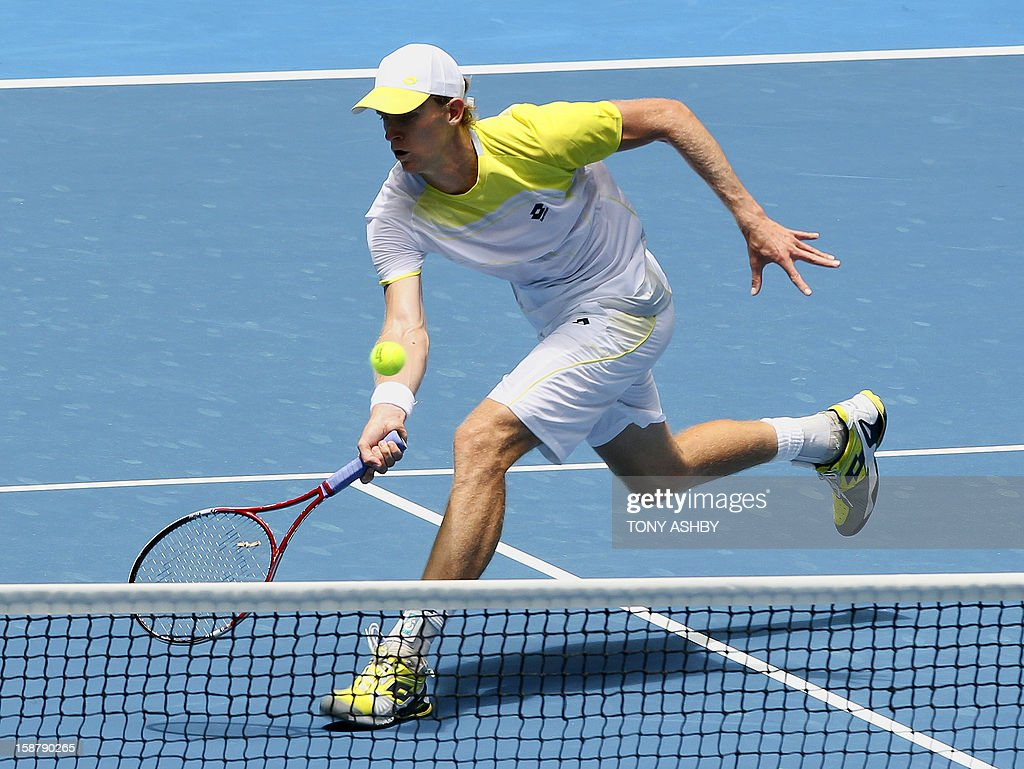 Kevin Anderson of South Africa hits a volley against Fernando Verdasco of Spain during their first session men's singles match on day one of the Hopman Cup tennis tournament in Perth on December 29, 2012. AFP PHOTO/Tony ASHBY USE