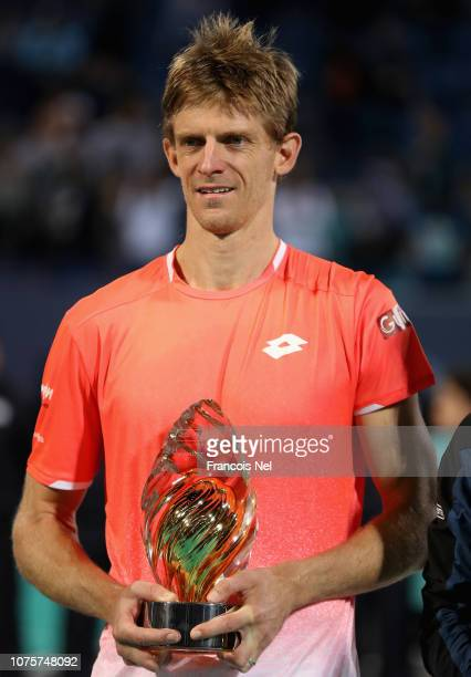 Kevin Anderson of South Africa holds the runnerup trophy after the men's final match of the Mubadala World Tennis Championship at International...