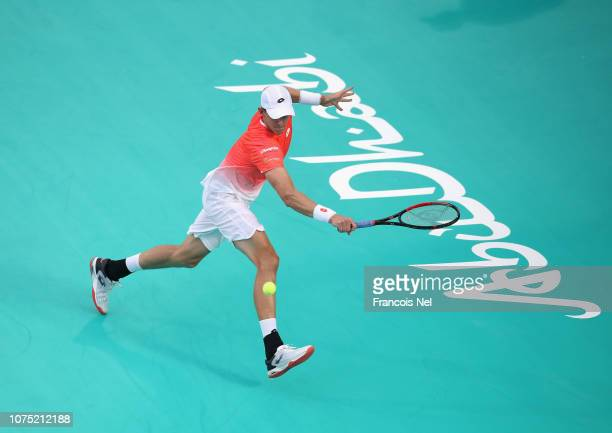 Kevin Anderson of South Africa plays a backhand against Hyeon Chung of South Korea during his men's singles match on day one of the Mubadala World...