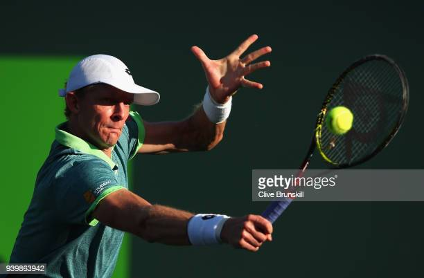 Kevin Anderson of South Africa plays a backhand against Pablo Carreno Busta of Spain in their quarterfinal during the Miami Open Presented by Itau at...