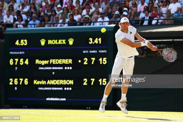 Kevin Anderson of South Africa plays a backhand against Roger Federer of Switzerland during their Men's Singles QuarterFinals match on day nine of...
