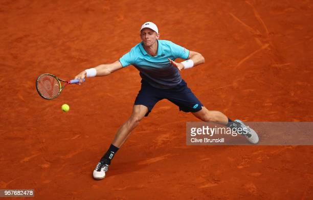 Kevin Anderson of South Africa plays a forehand against Dominic Thiem of Austria in their semi final during day eight of the Mutua Madrid Open tennis...