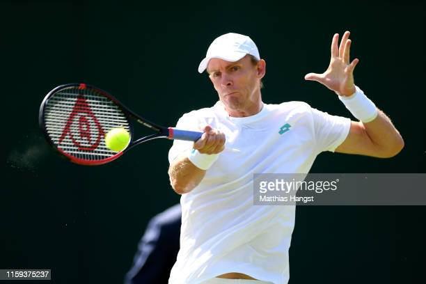 Kevin Anderson of South Africa plays a forehand during the Men's Singles first round match against PierreHugues Herbert of France during Day one of...