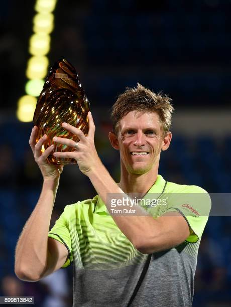 Kevin Anderson of South Africa poses with the trophy after winning his final match against Roberto Bautista Agut of Spain on day three of the...