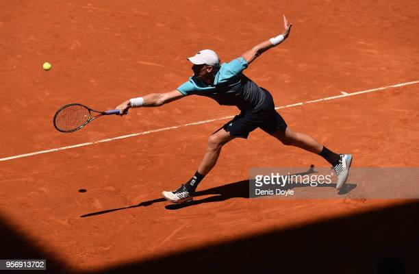 Kevin Anderson of South Africa returns a backhand to Philipp Kohlschreiber of Germany in their 3rd round match during day six of Mutua Madrid Open at...