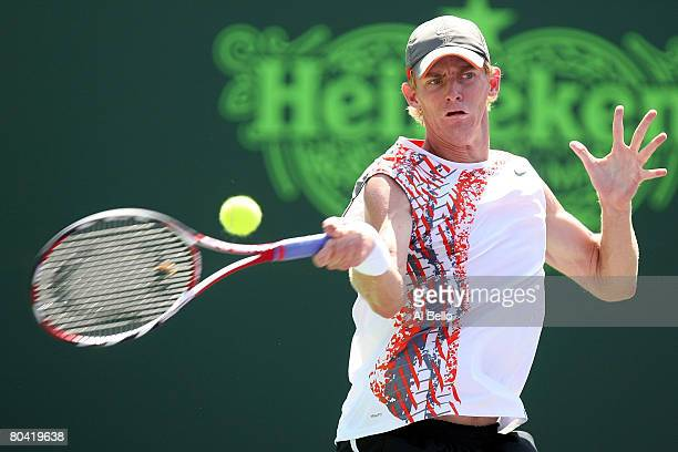 Kevin Anderson of South Africa returns a shot against Novak Djokovic of Serbia during day five of the Sony Ericsson Open at the Crandon Park Tennis...