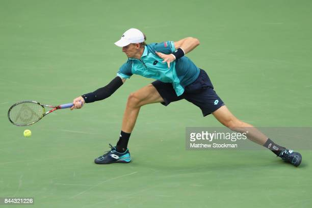 Kevin Anderson of South Africa returns a shot against Pablo Carreno Busta of Spain during their Men's Singles Semifinal match on Day Twelve of the...