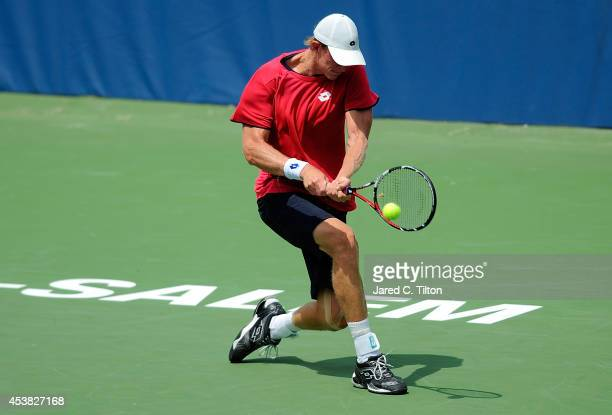Kevin Anderson of South Africa returns a shot from Adrian Mannarino of France during the Winston-Salem Open at Wake Forest University on August 19,...