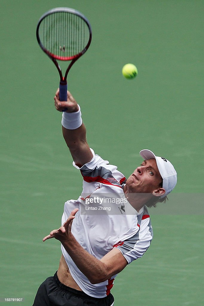 Kevin Anderson of South Africa returns a shot to John Isner of the United States during the day three of Shanghai Rolex Masters at the Qi Zhong Tennis Center on October 9, 2012 in Shanghai, China.