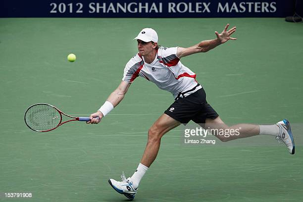 Kevin Anderson of South Africa returns a shot to John Isner of the United States during the day three of Shanghai Rolex Masters at the Qi Zhong...