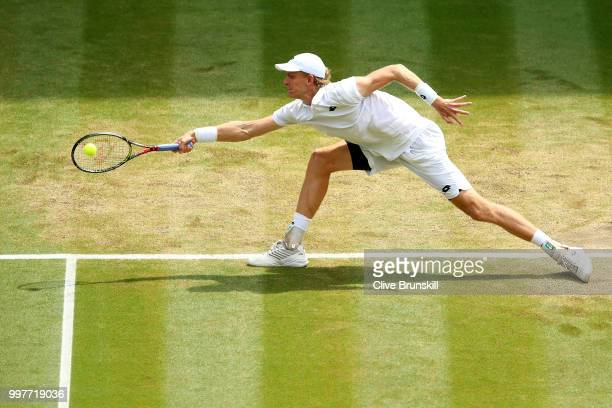 Kevin Anderson of South Africa returns against John Isner of The United States during their Men's Singles semifinal match on day eleven of the...