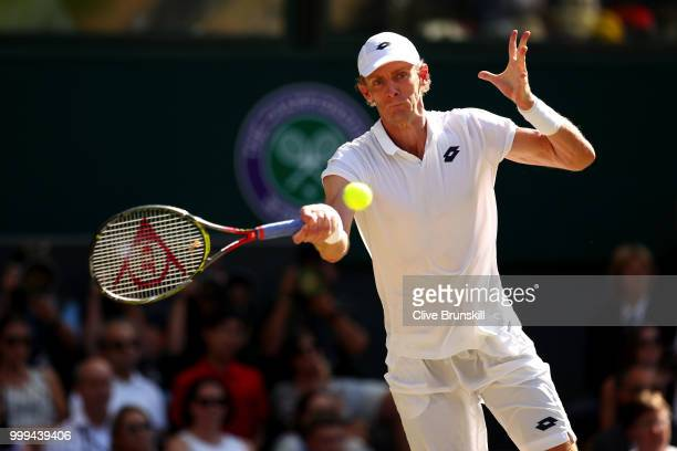 Kevin Anderson of South Africa returns against Novak Djokovic of Serbia during the Men's Singles final on day thirteen of the Wimbledon Lawn Tennis...