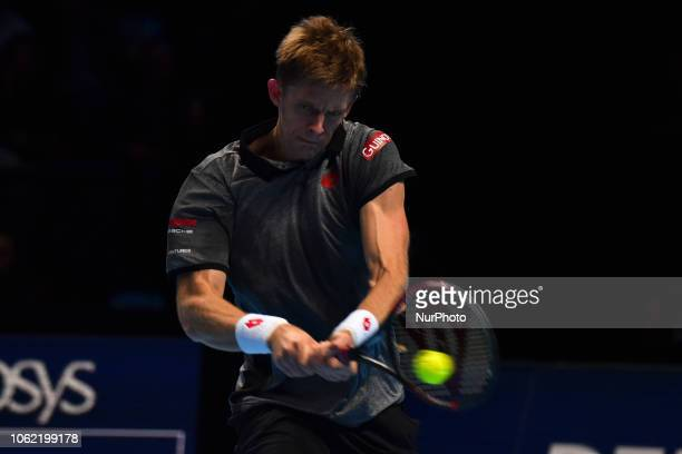 Kevin Anderson of South Africa returns the court during his round robin match against Roger Federer of Switzerland during Day Five of the Nitto ATP...