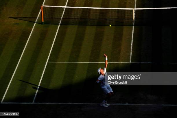 Kevin Anderson of South Africa serves against Gael Monfils of France during their Men's Singles fourth round match on day seven of the Wimbledon Lawn...