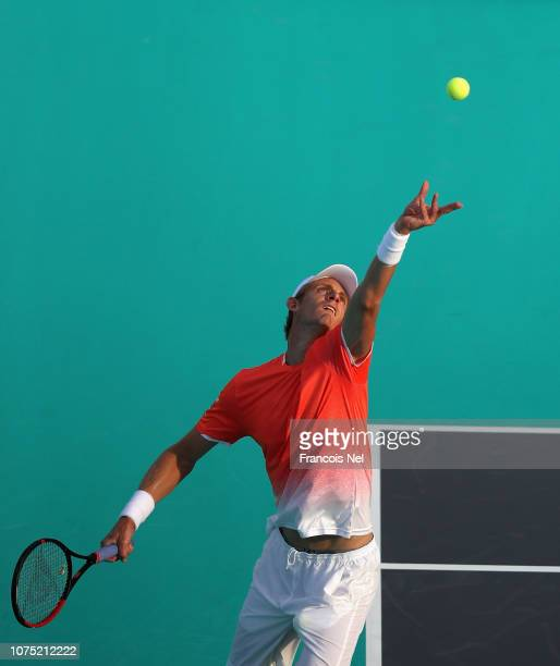 Kevin Anderson of South Africa serves during his men's singles match on day one of the Mubadala World Tennis Championship at International Tennis...