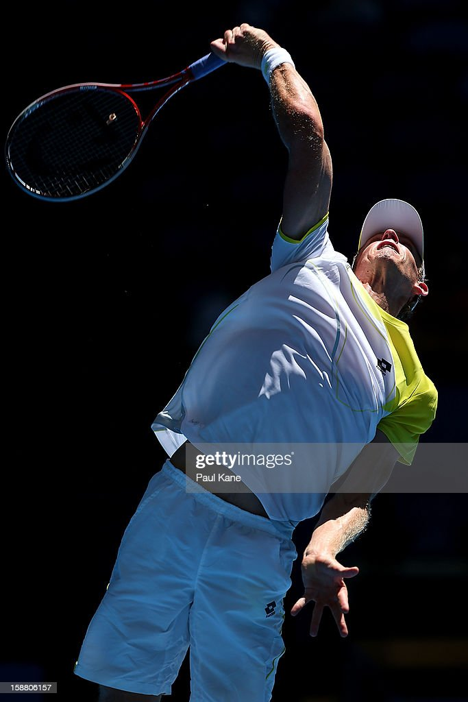 Kevin Anderson of South Africa serves in his singles match against John Isner of the USA during day two of the Hopman Cup at Perth Arena on December 30, 2012 in Perth, Australia.