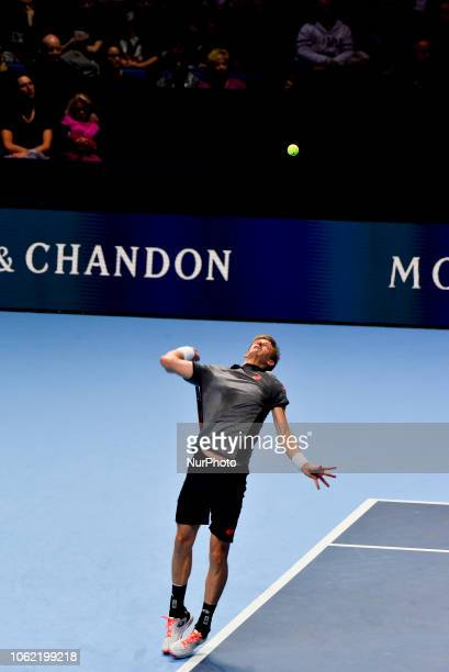 Kevin Anderson of South Africa serves the court during his round robin match against Roger Federer of Switzerland during Day Five of the Nitto ATP...