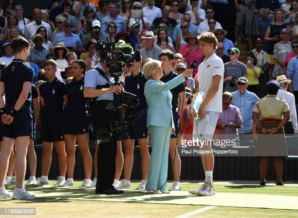 Kevin Anderson of South Africa talks to BBC presenter Sue Barker after losing the gentlemen's singles final match against Novak Djokovic of Serbia on...