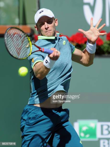 Kevin Anderson returns a shot during the third set of a quarterfinals match played during the BNP Paribas Open on March 15 2018 at the Indian Wells...