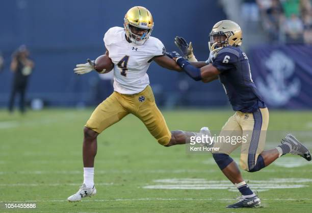 Kevin Austin of the Notre Dame Fighting Irish runs with the ball in the 1st half against the Navy Midshipmen at SDCCU Stadium on October 27 2018 in...