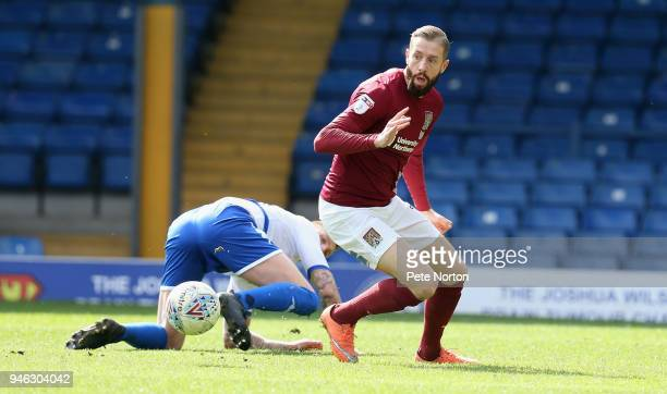 Kevin avn Veen of Northampton Town contests the ball with Peter Clarke of Bury during the Sky Bet League One match between Bury and Northampton Town...