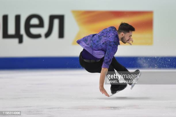 Kevin Aymoz of France falls as he performs in the men's short programme event of the ISU European Figure Skating Championships at the Steiermark hall...