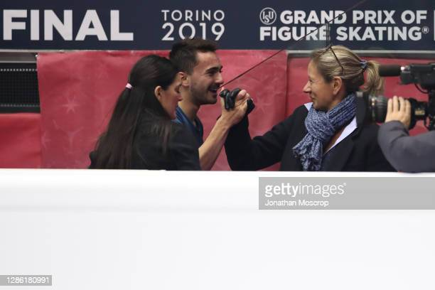 Kevin Aymoz of France pictured with his Italian coach Silvia Fontana and Katia Krier following his performance in the Men's Free Skating during the...