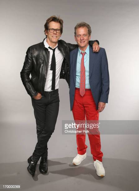 Kevin Bacon and Michael Bacon of the Bacon Brothers pose at the Wonderwall portrait studio during the 2013 CMT Music Awards at Bridgestone Arena on...
