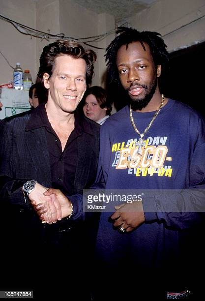 Kevin Bacon and Wyclef Jean during TNT Presents A Gift of Song New York January 1 1997 in New York City New York United States