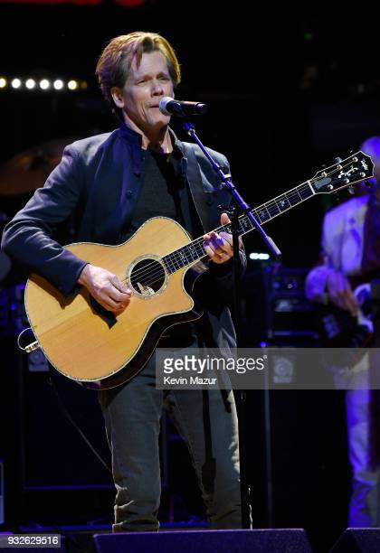 Kevin Bacon of the Bacon Brothers performs onstage at the Second Annual LOVE ROCKS NYC A Benefit Concert for God's Love We Deliver at Beacon Theatre...