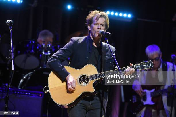 Kevin Bacon performs onstage at the Second Annual LOVE ROCKS NYC A Benefit Concert for God's Love We Deliver at Beacon Theatre on March 15 2018 in...