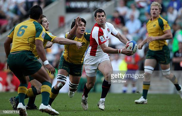 Kevin Barrett of England is tackled during Pool D match between England and Australia during day one of the IRB London Sevens at Twickenham Stadium...