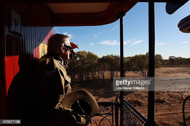 Kevin Bathurst of the '1st Light Horse Regiment' from Rockhampton looks out at the view from the ANZAC Troop Train on April 21 2015 in Longreach...