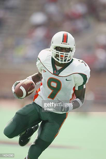 Kevin Beard of the Miami Hurricanes runs the ball during the NCAA football game against the Temple Owls at Franklin Field in Philadelphia,...