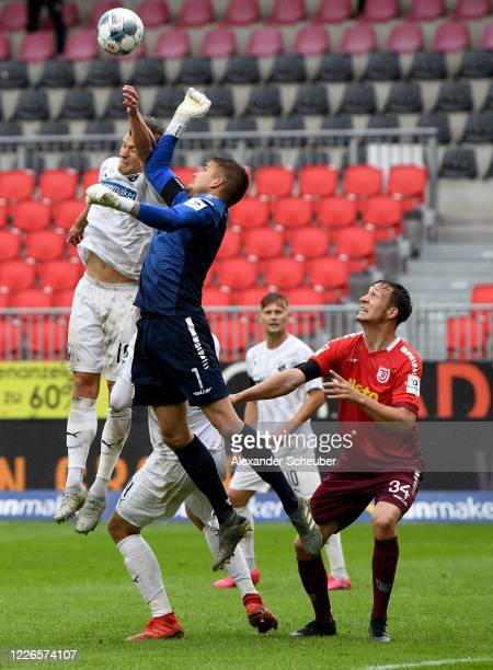 Kevin Behrens of Sandhausen challenges Alexander Meyer, goalkeeper of Regensburg during the Second Bundesliga match between SV Sandhausen and SSV...