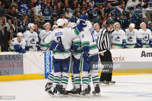 Kevin Bieksa and Ryan Kesler of the Vancouver Canucks celebrate with teammates after a goal against the Los Angeles Kings in Game Three of the...