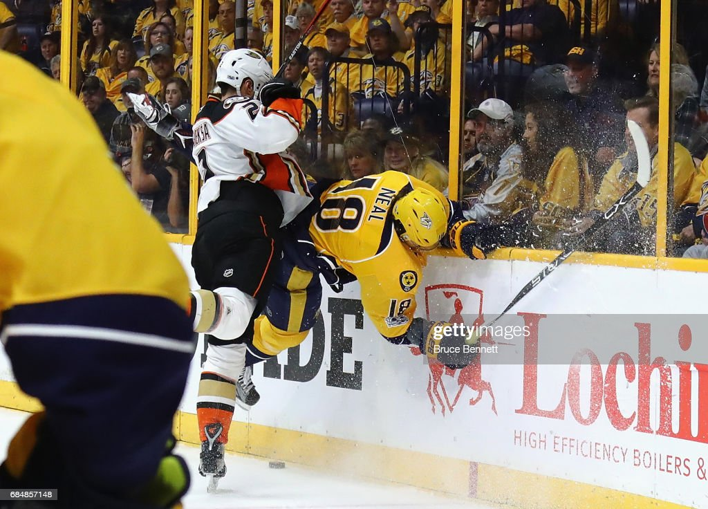 Kevin Bieksa #2 of the Anaheim Ducks checks James Neal #18 of the Nashville Predators during the first period in Game Four of the Western Conference Final during the 2017 Stanley Cup Playoffs at Bridgestone Arena on May 18, 2017 in Nashville, Tennessee.