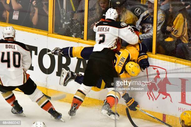 Kevin Bieksa of the Anaheim Ducks checks James Neal of the Nashville Predators during the first period in Game Four of the Western Conference Final...