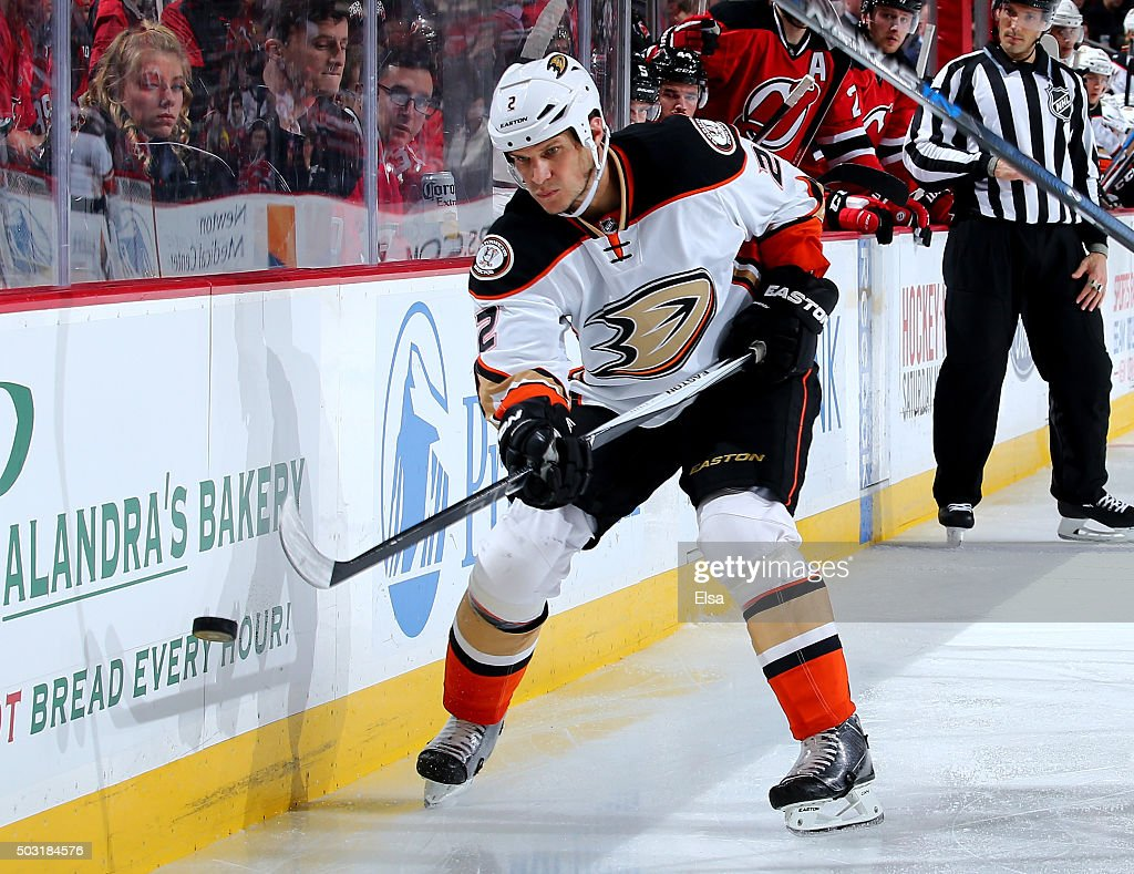 Kevin Bieksa #2 of the Anaheim Ducks keeps the puck in the offensive zone in the third period against the New Jersey Devils on December 19, 2015 at Prudential Center in Newark, New Jersey.The Anaheim Ducks defeated the New Jersey Devils 2-1.