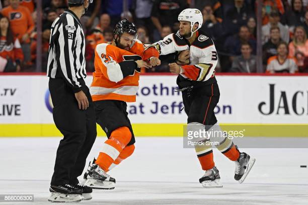 Kevin Bieksa of the Anaheim Ducks punches Radko Gudas of the Philadelphia Flyers as they fight during the first period at Wells Fargo Center on...