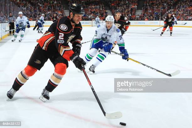 Kevin Bieksa of the Anaheim Ducks skates with the puck against Joseph Cramarossa of the Vancouver Canucks during the game on March 4 2017 at Honda...