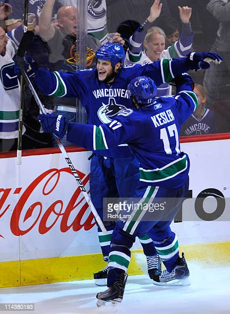 Kevin Bieksa of the Vancouver Canucks celebrates his second period goal against the San Jose Sharks in Game Two of the Western Conference Finals...