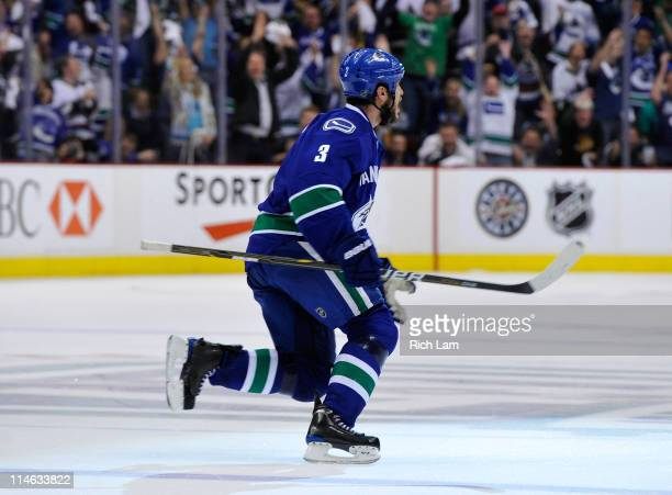 Kevin Bieksa of the Vancouver Canucks skates to center to celebrate after scoring the game-winning goal in double overtime to win the Western...