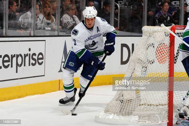 Kevin Bieksa of the Vancouver Canucks skates with the puck against the Los Angeles Kings in Game Four of the Western Conference Quarterfinals during...