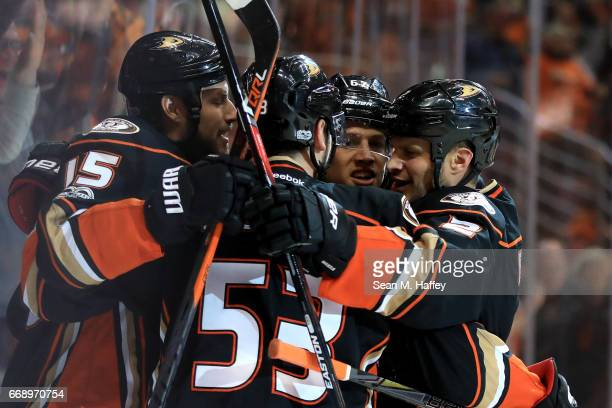 Kevin Bieksa Ryan Getzlaf and Shea Theodore of the Anaheim Ducks celebrate a goal during the first period of Game Two of the Western Conference First...